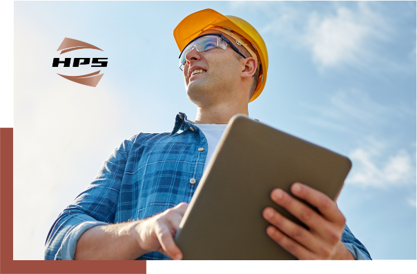 Man in hard hat holding a tablet